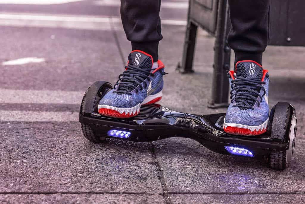 Feet standing on hoverboard with lights